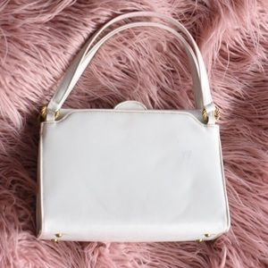 Vintage white patent purse with gold accents